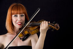 Violin player holding violin, woman with red hair Stock Photography