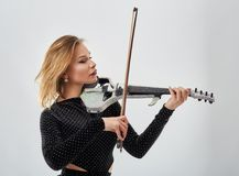 Violin player lady. Woman violin player, studio shot Stock Images
