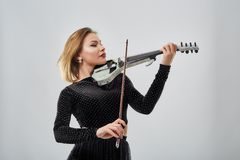 Violin player lady. Woman violin player, studio shot Royalty Free Stock Images
