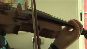 Violin player playing stock footage