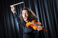 Violin player playing the intstrument Stock Photo