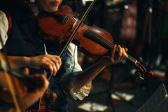 Violin Player of Serbian Folklore. Female violinist, dressed in Serbian traditional clothe playing for music folklore ensemble Royalty Free Stock Photography