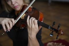 Violin player violinist classical music playing. Orchestra musical instruments royalty free stock photography