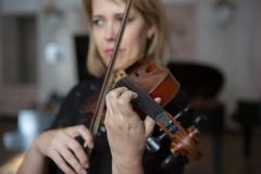 Violin player violinist classical music playing. Orchestra musical instruments stock photography