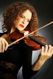 Violin player violinist woman Stock Images