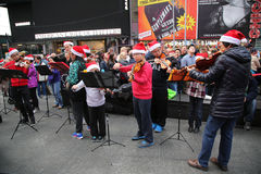 Violin players perform Christmas songs at Times Square on Christmas Day in Manhattan Royalty Free Stock Photo