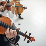 Violin players performing. Professional violinists performing, male player on foreground, blank copy space on the right Royalty Free Stock Image
