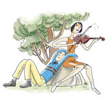 Violin playing couple. A woman is playing violin to her partner in  a park Royalty Free Stock Photos