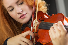 Violin playing. Details of violin playing close-up. Focus on bow Stock Photos