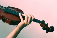 Violin playing with hand Royalty Free Stock Images