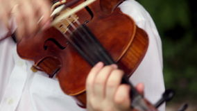 Violin playing stock video footage