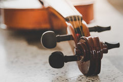 Violin put on the floor with vintage tone filter. Stock Photos