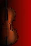 Violin on a red background Royalty Free Stock Photo
