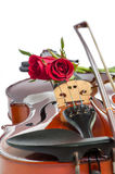 Violin and red roses. Violin and two red roses on white background Stock Image