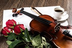 Violin, rose, coffee and music books Royalty Free Stock Images