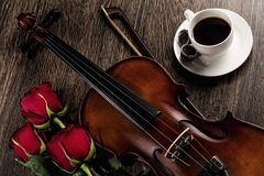 Violin, rose, coffee and music books Royalty Free Stock Image
