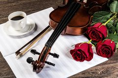 Violin, rose, coffee and music books Royalty Free Stock Photo