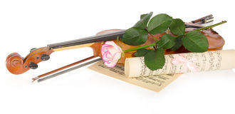 Violin and rose. Violin, fiddlestick, notes and a rose, isolated on white Royalty Free Stock Photo