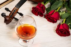 Violin, rose, glass of champagne and music books Royalty Free Stock Photo