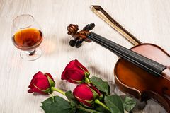 Violin, rose, glass of champagne and music books Royalty Free Stock Image