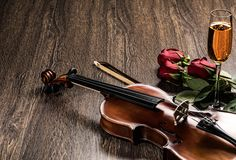 Violin, rose, glass of champagne and music books Royalty Free Stock Images