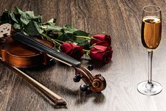 Violin, rose, glass of champagne and music books Royalty Free Stock Photos