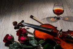 Violin, rose, glass of champagne and music books Stock Photo