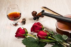 Violin, rose, glass of champagne and music books Stock Image