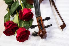 Violin, rose and music books. Still life Royalty Free Stock Photos