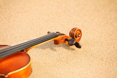 Violin on sandy beach. Music concept Royalty Free Stock Image