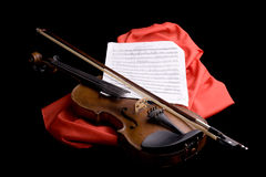 Violin on scarlet silk Royalty Free Stock Images