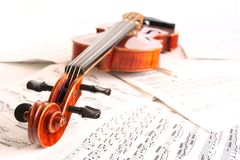 Violin on scores Stock Photos