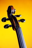 Violin Scroll Closeup Yellow Bk Stock Photography