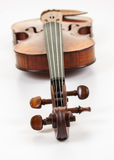 Violin with scroll at fore Royalty Free Stock Photo