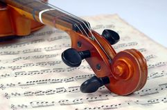 Violin Scroll With Miusic Sheet Stock Image