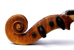 Violin scroll and pegbox. Closeup of the side of a violin scroll and pegbox with tuning pegs Stock Image