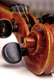 Violin scroll and pegbox. Macro closeup of a violin scroll and pegbox with tuning pegs Stock Image