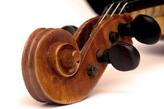 Violin scroll and pegbox. Closeup of a violin scroll and pegbox with tuning pegs Stock Photo