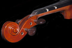 Violin scroll and tunning pegs Royalty Free Stock Photos
