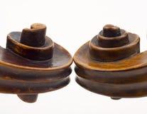Violin scrolls Stock Photography