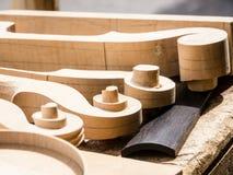 Violin scrolls Stock Image