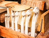 Violin scrolls Stock Images