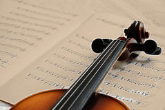 Violin on sepia music paper Royalty Free Stock Images