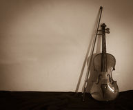 Violin sepia tone with hard shadow Stock Photos