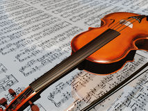 Violin on sheet music backdrop. With clouds reflecting Stock Image