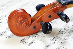 Violin on sheet music. close up. Stock Photography