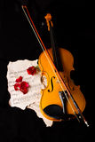 Violin sheet music and rose Stock Images