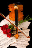Violin sheet music and rose closeup wood Stock Photo