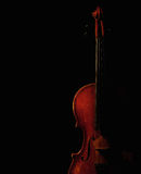 Violin silhouette. Vintage violin silhouette on black background Royalty Free Stock Images