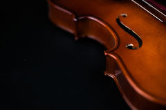 Violin Silouhette on dark background. With space for text on the left Royalty Free Stock Photos